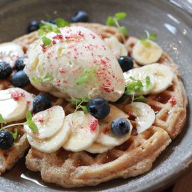 Banana and blueberry wholemeal waffles, organic amply syrup, banana ricotta and strawberry dust (AUD16)