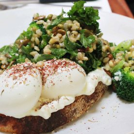 Superfood breakfast! Avocado, kale, broccoli flowerette, barley, mung sprouts, green chilli and pumpkin seeds on toast with light cottage cheese and free range eggs (AUD 18.50)