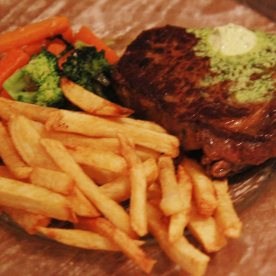 "L'Entrecote de Paris - Grilled Rib Eye Steak with ""Café de Paris"" Butter French Fries & Sautéed Vegetables"
