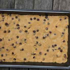 Press the cookie dough out onto the tray