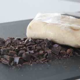 Take the dough out from the refrigerator and chop up the chocolate chunks.