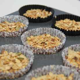 Sprinkle the muesli or oats on top of the muffin batter.