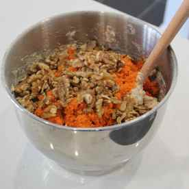 Add in the pitted dates mixture, grated carrots and walnuts and mix it well (this requires some arm muscle as it's a big bowl of mixture)