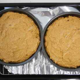 Spread the batter out into two cake tins and place it into the oven to bake