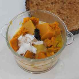 Place the sugar, salt, cinnamon, beaten eggs, olive oil, milk and boiled/steamed pumpkin into the food processor.