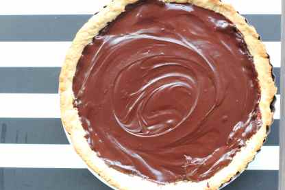 Once the tart is ready, let it cool down for a while then pour the chocolate mixture over it. Leave it to cool and place into the fridge to chill for at least 2-3hr.