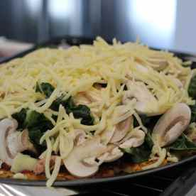 Add whatever ingredients you like onto the base and bake it in the oven for 15min