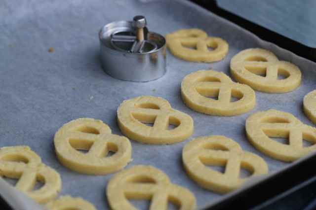 Take the dough out from the fridge. Using a pretzel cutter, cut out  the pretzels