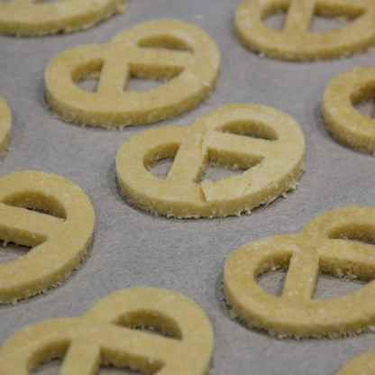 Roll the dough out and using a cookie cutter, cut out the cookies and bake it in the oven until it turns golden brown